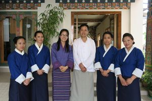Dr. Sherab Tenzin at medical center with team