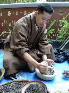 Dr. Sherab Tenzin making plants medicine